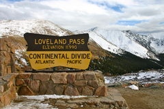Loveland Pass Colorado Continental Divide Sign. Continental Divide sign at Loveland Pass in Colorado with snow capped mountains in the background stock photos