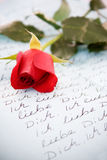 Loveletter. Red rose and loveletter in german language Royalty Free Stock Photography