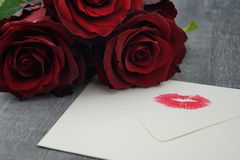 Love is all around. A loveletter from your valentine, red roses and the wedding ring as an external sign of inner connectedness Royalty Free Stock Photography