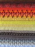 Loveley crochet blanket. In the colors orange, yellow, white, brown, red stock images