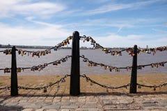 Lovelocks, symbols of love attached to bridge railing Stock Photos