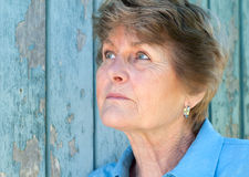Lovely 70 year old woman looking up in thought Stock Photos