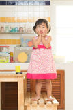 Lovely acting of little children dinning table in home kitchen r Stock Photo