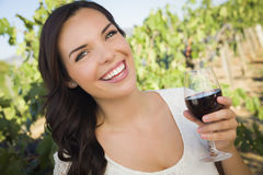Lovely Adult Woman Enjoying A Glass of Wine in Vineyard Royalty Free Stock Photos