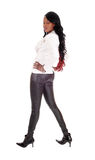Lovely African American woman in leather pants. Stock Photo
