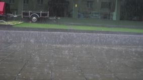 Lovely amazing low angle satisfying slow motion view on rain drops fall calm on grey wet pavement asphalt concrete road. Lovely amazing low angle satisfying slow stock video footage