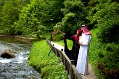 Lovely arabian couple in traditional clothes embracing outdoors Royalty Free Stock Photography