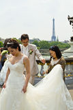 Lovely Asia couple wedding pictures on Pont Alexandre III bridge in Paris Royalty Free Stock Images