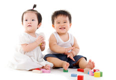 Lovely asian babies. Playing toys royalty free stock photos