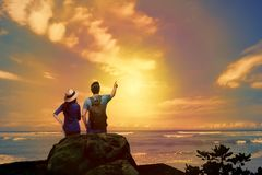 Lovely asian couple looking at sunset panorama royalty free stock photos