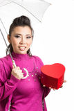 Lovely Asian girl hold gift Stock Photo