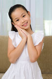 Lovely asian girl. Indoor portrait of a lovely asian girl Royalty Free Stock Photography