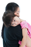 Lovely asian girl relaxing on mom's shoulder, happy family conce Stock Images