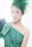 Lovely asian girl. Wearing green lace skirt isolated on white background royalty free stock photo