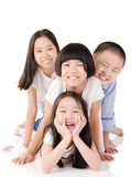Lovely asian kids. Lying on the floor royalty free stock photography