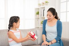 Lovely asian little girl send a gift to her mother Royalty Free Stock Photos