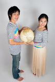 Lovely Asian Thai Spouse. Asian Thai spouse hold Globe by their hands Stock Photo