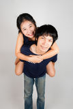 Lovely Asian Thai Spouse. Asian Thai wife rides pickaback her husband Royalty Free Stock Photography