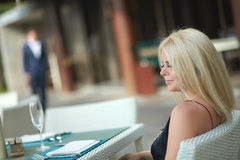 Lovely, attractive woman sitting in restaurant. Stock Photos