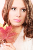 Lovely autumnal girl with maple leaves in hand Royalty Free Stock Photo