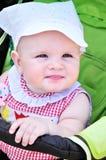Lovely baby. Girl sitting in the stroller Stock Images