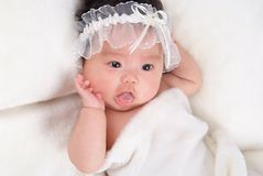 Lovely baby. Is on a bed Royalty Free Stock Images