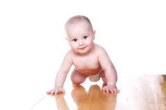 Lovely  baby 6 month old in diaper. Lovely smiling baby 6 month old in diaper at flat Royalty Free Stock Image