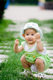 Lovely baby. A lovely baby play in the garden Stock Photos