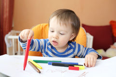 Lovely baby age of 1 year painting Stock Photo