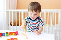 Lovely baby boy painting Stock Photos