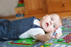 Lovely baby boy playing at home. Royalty Free Stock Images