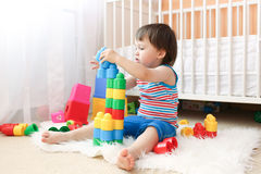 Lovely baby boy playing plastik toys Royalty Free Stock Photography