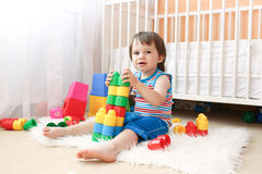 Lovely baby boy playing toys at home Stock Photo