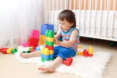 Lovely baby boy playing toys Royalty Free Stock Images