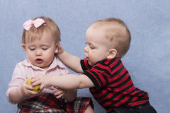 Lovely baby boy and pretty baby girl playing together Royalty Free Stock Photography