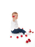 Lovely baby boy with red balls Royalty Free Stock Photography