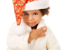 Lovely baby in Christmas hat and fur Royalty Free Stock Image
