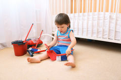 Lovely baby cleaning his room Royalty Free Stock Photos