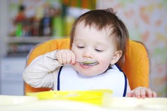 Lovely baby eating Royalty Free Stock Images