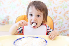 Lovely baby eating quark Royalty Free Stock Images