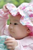 Lovely baby with a flower hat Royalty Free Stock Photography