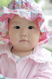 Lovely baby with a flower hat Royalty Free Stock Photos