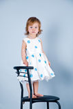 Lovely baby girl in dress Stock Photos