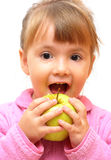 Lovely baby-girl eating apple royalty free stock images