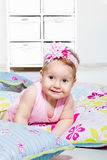 Lovely baby girl lying on the  pillows Stock Photography