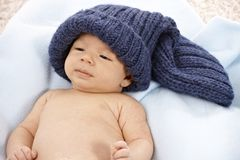 Lovely baby in knitted hat Stock Images
