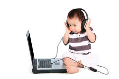 Lovely baby listening to music Royalty Free Stock Image