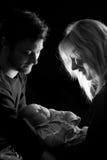 Lovely baby loving couple. Loving couple holding their newborn little baby Stock Photo