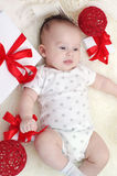 Lovely baby lying among gifts Royalty Free Stock Photography