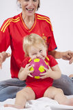 Lovely baby and mother spanish soccer fans Royalty Free Stock Photos